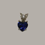 14 kt. white gold heart shaped Sapphire and diamond pendant